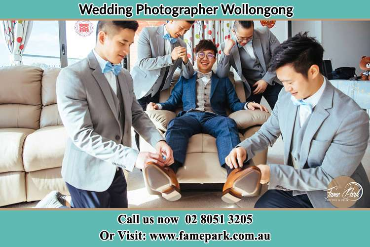 The Groom being prepared by his groomsmen before the wedding Wollongong